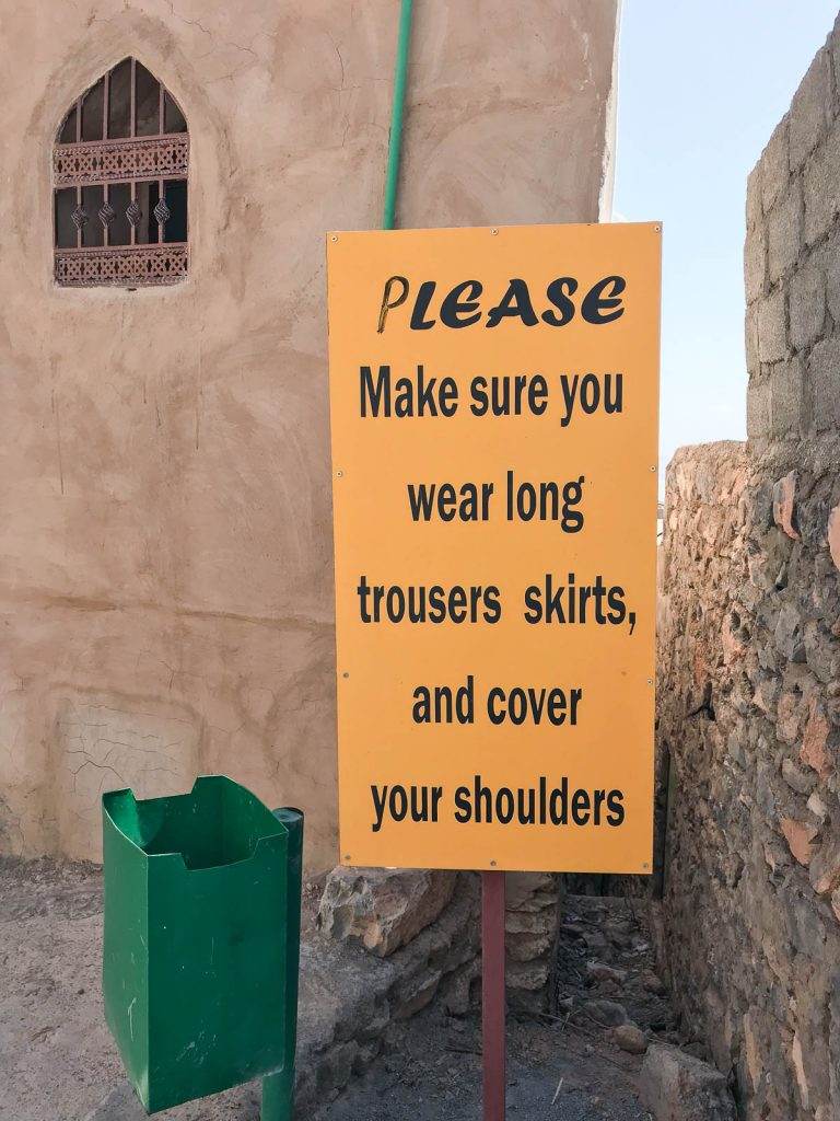 Sign about dress code, Oman