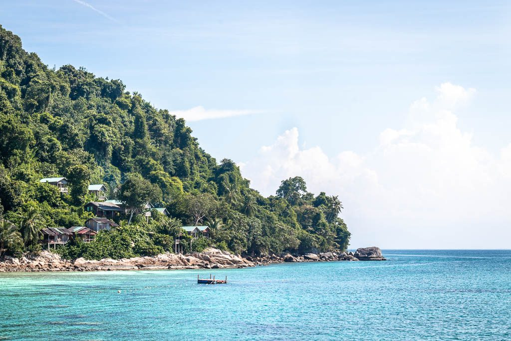 Huts overlooking the ocean surrounding the Perhentian Islands, Malaysia.